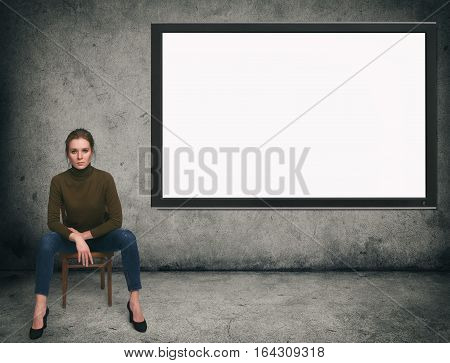 Concrete Room With A Tv Screen On The Wall