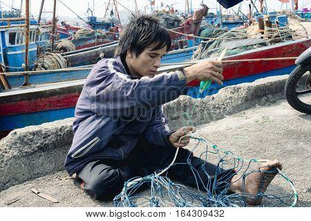 Craftsman Making A Fish Net in Da Nang. December 26 2013 - Vietnam