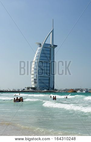 DUBAI UNITED ARAB EMIRATES - DECEMBER 9 2016: Cityscape of Burj Al Arab Hotel from Jumeirah beach. It is a luxury hotel located in Dubai United Arab Emirates the fourth tallest hotel in the world.