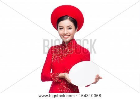 Smile Vietnamese woman in dress traditional Ao Dai and introduce product on white background.