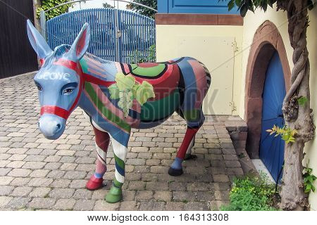 Leinsweiler, Germany - September 10 2013: Color statue of a donkey