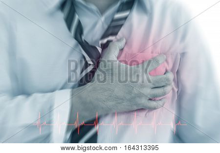 Front view of a businessman with cardiology (heart disease) red around the area of pain. poster