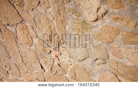 Abstract Grunge Stonewall Background. Decorative Finishing Wall Building Fence of Natural Stone. Rough Surface Rock Texture Horizontal Image Close up