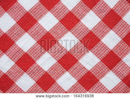 Natural Cotton Waffle Diagonal weave Fabric Cloth texture. Red and White Checkered Kitchen towel textile Background or Wallpaper close up. Web banner Horizontal Image With Copy Space. Top view