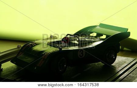 Miniature model of a racing car. Kids racing car toy.
