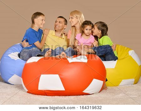 Portrait of a big happy family on a sofa