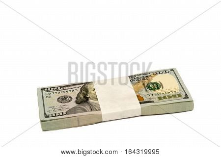 Stack of cash money in hundred dollar banknotes isolated with copy space