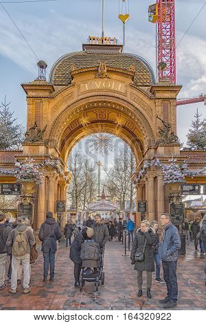 COPENHAGEN DENMARK - DECEMBER 23 2016: Many happy customers leaving the Tivoli Gardens amusement park in Copenhagen. The park opened on 15 August 1843 and is the oldest operating amusement park in the world.