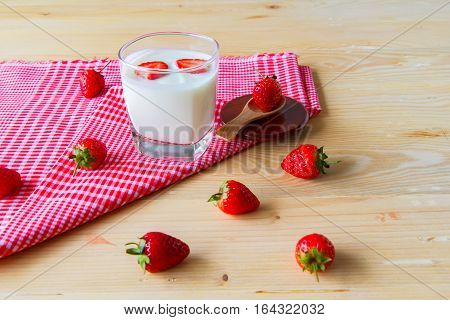 strawberry in yogurt with Put on a red table cloth background heart in yogurt with valentine 's day.
