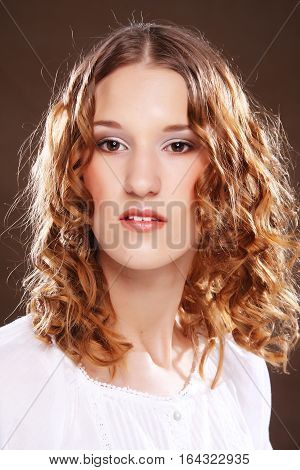 Beautiful girl with long wavy hair, redhair with curly hairstyle