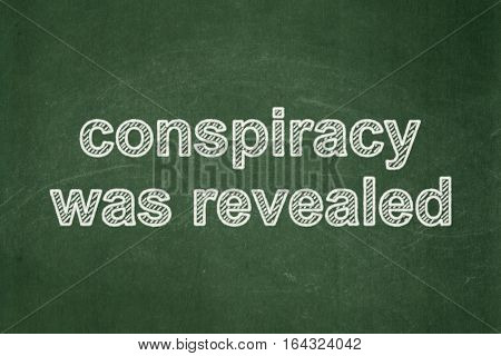 Political concept: text Conspiracy Was Revealed on Green chalkboard background