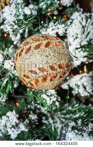 Christmas toy on the Christmas tree closeup
