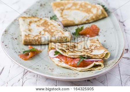 cheese pancakes with salmon sour cream and herbs