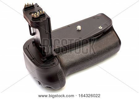 Battery grip for modern DSLR camera isolated on white background.