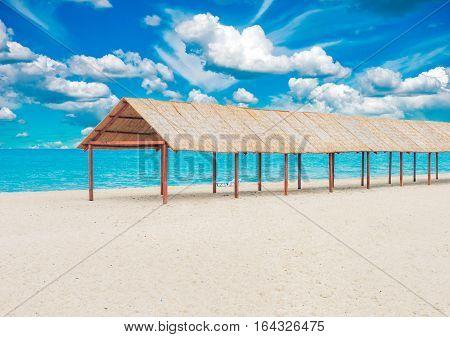 Beautiful tropical sandy beach with sun canopy