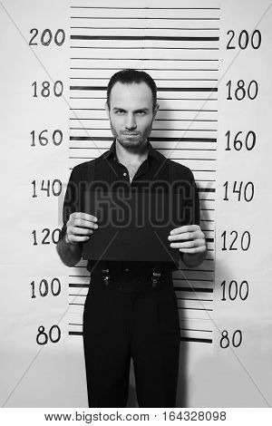 Portrait of criminal man on detective party