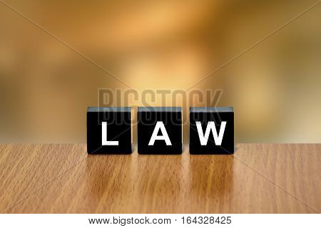 law on black block with blurred background