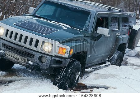 The river Tosno, Leningrad oblast, Russia - January 01, 2017, H3 Hammer on the shore of the river, the Hummer H3 is a compact SUV produced by GM