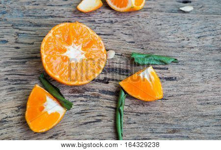 Fresh orange and leaf on wooden background cross section orange on wooden fiber aids digestion Dietary fiber