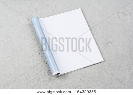 Mock-up magazine or catalog on concrete. Blank page or notepad on construction background. Blank page or notepad for mockups or simulations.