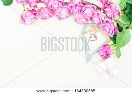 Valentines day violet roses with heart top view flat ly scene