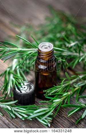 Rosemary Essential Oil And Fresh Rosemary