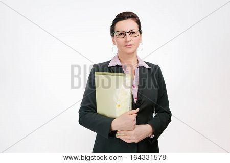 Beautiful businesslady in black jacket isolated on white background