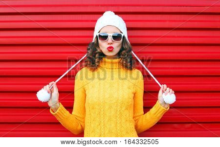 Fashion Cool Girl Blowing Red Lips Makes Air Kiss Wearing Colorful Knitted Yellow Sweater Hat Over R