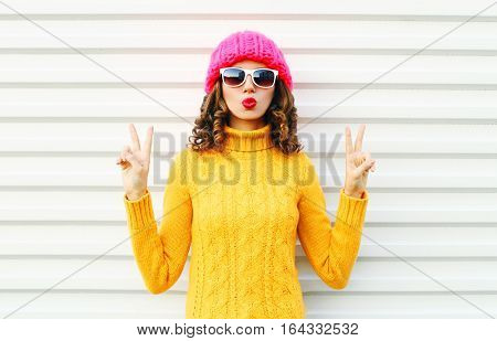 Fashion Cool Girl Blowing Red Lips Makes Air Kiss Wearing Colorful Knitted Yellow Sweater Hat Over W