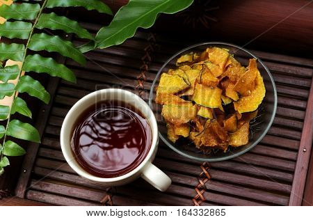 Tea and Sweet Pumpkin Cracker in The Wooden Tray