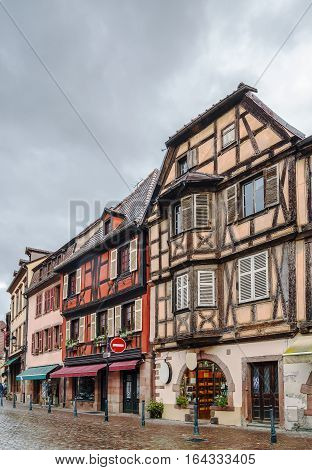 Street with historical half-timbered houses in Kaysersberg Alsace France