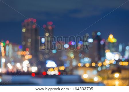 Twilight blurred bokeh city downtown lights night view abstract background