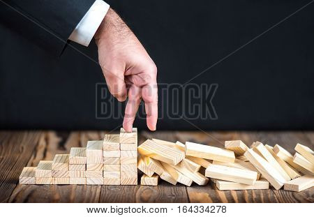 Businessman Coming To The End Of His Career Unsuccessful Business Life Concept With Wooden Blocks On Rustic Desk