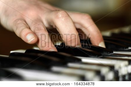 Stylized hand of pianist in motion close up