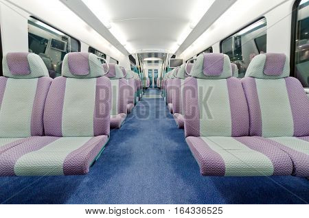 View of contemporary train interior. Empty seats.