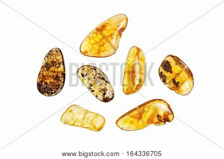 Seven stones yellow amber on a white background.