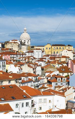 View of the Alfama Neighbourhood in Lisbon Portugal with colorful buildings and the National Pantheon