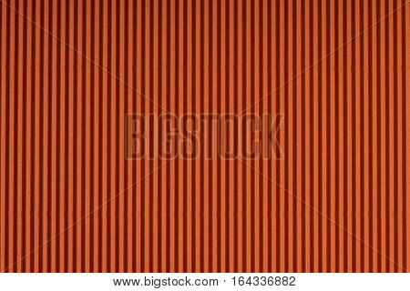 Striped embossed orange paper. Colored paper texture background