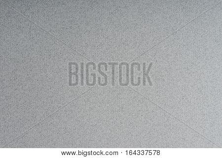 Dark gray rippled paper pattern, texture background.