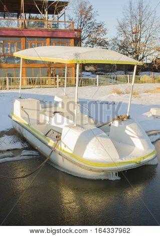 catamarans under snow in winter, ice icicles