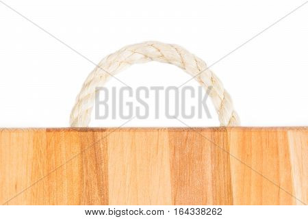 Tree texture. Timber light natural pattern. Wood grain background. Rope handle wooden cutting board.