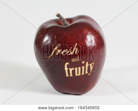 1 fresh red Apple labeled 'fresh and fruity' on a white background