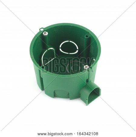 Green plastic container for electric wire mounting isolated on white  background closeup