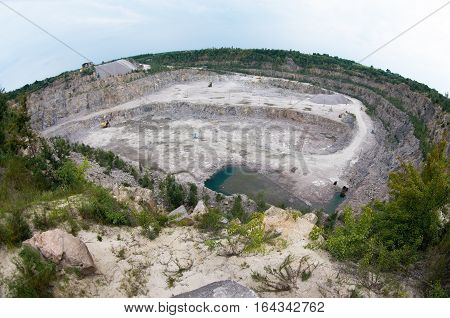 fish-eye view of the granite quarry. Mining industry.