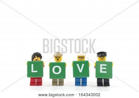 Chiang Mai Thailand - January 8 2017 : Studio shot of LEGO minifigure holding word LOVE on white background