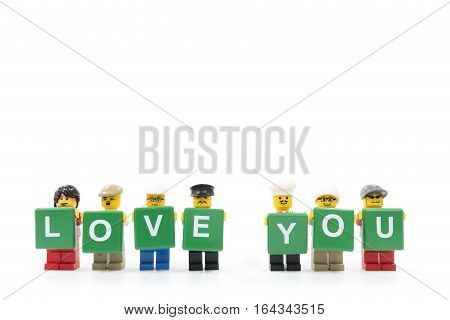 Chiang Mai Thailand - January 8 2017 : Studio shot of LEGO minifigure holding word LOVE YOU on white background