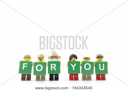 Chiang Mai Thailand - January 8 2017 : Studio shot of minifigure holding word FOR YOU on white background