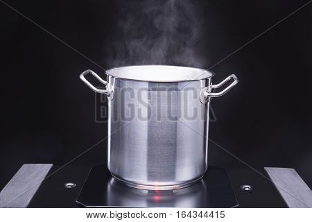 From the pot goes to the steam cooking surface.