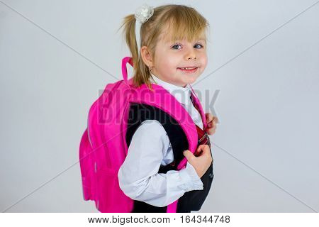 Portrait Of Young Schoolgirl With Schoolbag