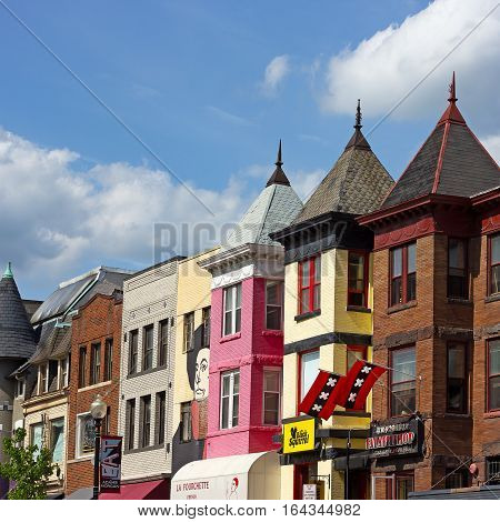 WASHINGTON DC USA - MAY 9: Buildings with popular restaurants in Adams Morgan neighborhood on May 9 2015 in Washington DC. Vibrant city neighborhood on a sunny afternoon.